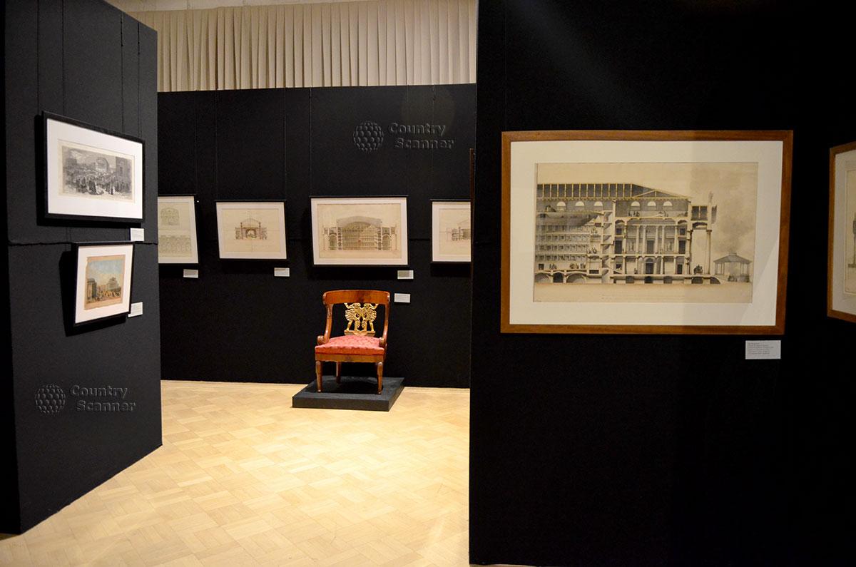 Общие виды и разрезы проектируемых зданий в архитектурном музее имени Щусева. Антикварное кресло – не инвентарь служительницы, а полноценный экспонат.