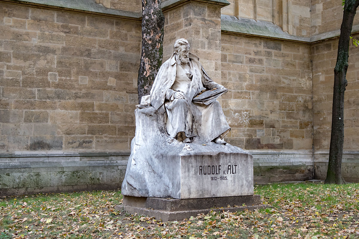 Монумент известному художнику Рудольфу фон Альту, установленный возле церкви Миноритов, создан скульптором Гансом Шерпе.